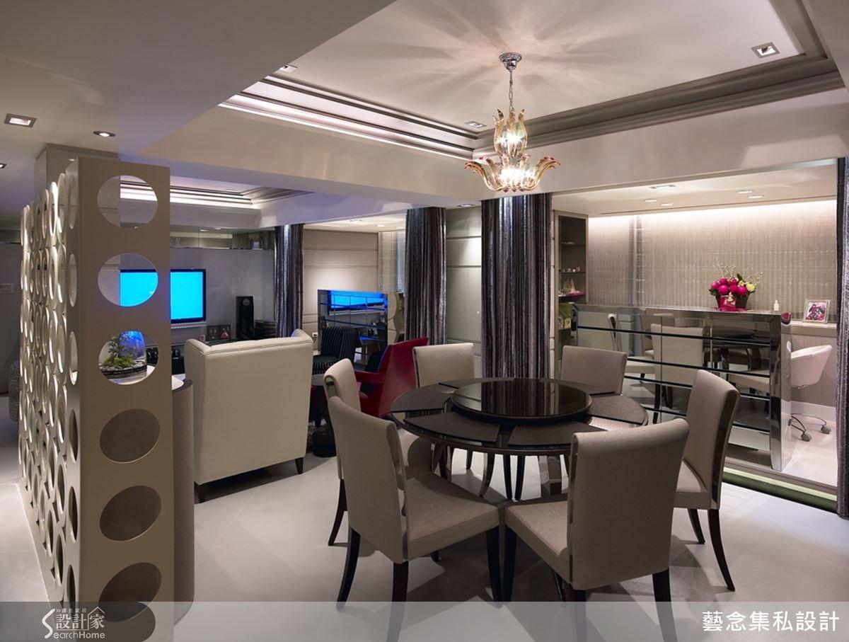 天花板吊掛著一盞晶瑩剔透如水仙般的造型燈,溫馨而別緻的用餐環境。餐廳與客廳之間則以圓形鏤空的造型隔牆,讓視覺效果上有隱約的親密性。