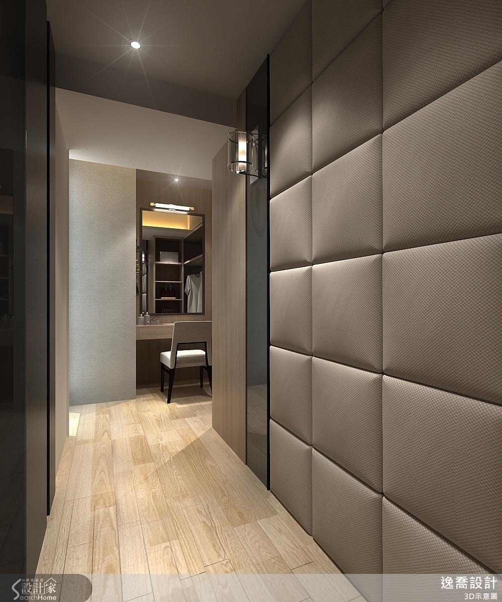 主臥房的更衣室以繃布作為牆面材質,運用色系與材質形塑精品宅的質感。