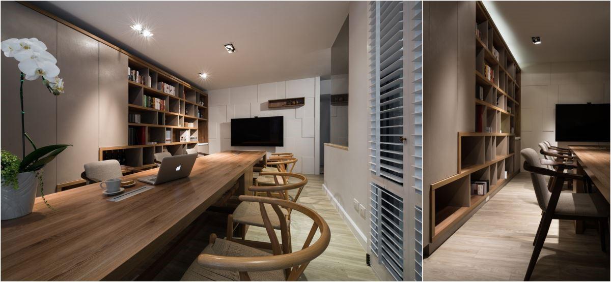 會議室的電視牆,利用材質本體厚度不同的拼接方式,即便是全白色的主牆也能呈現出不失焦卻又充滿設計感的層次。側方的收納櫃利用階梯式的設計,創造空間的層次感與電視牆同概念,而色調上則與會議桌呼應表現整體感。會議室除了整體性與層次感的表現上,還有許多貼心的規劃於其中,如側方櫃體的開合,皆為隱藏式無把手櫃(俗稱拍拍手);會議桌於訂製時,早已預留了筆電等 3C 產品的線孔,使視覺遼闊感再升級。