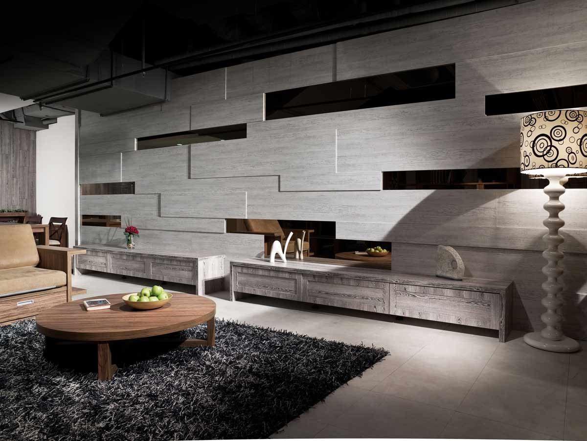 石紋與鏡面材質板材所組成的電視牆,運用交錯與層疊的排列,創造視覺上遠近不一的線條,另成一景,增添立體感。