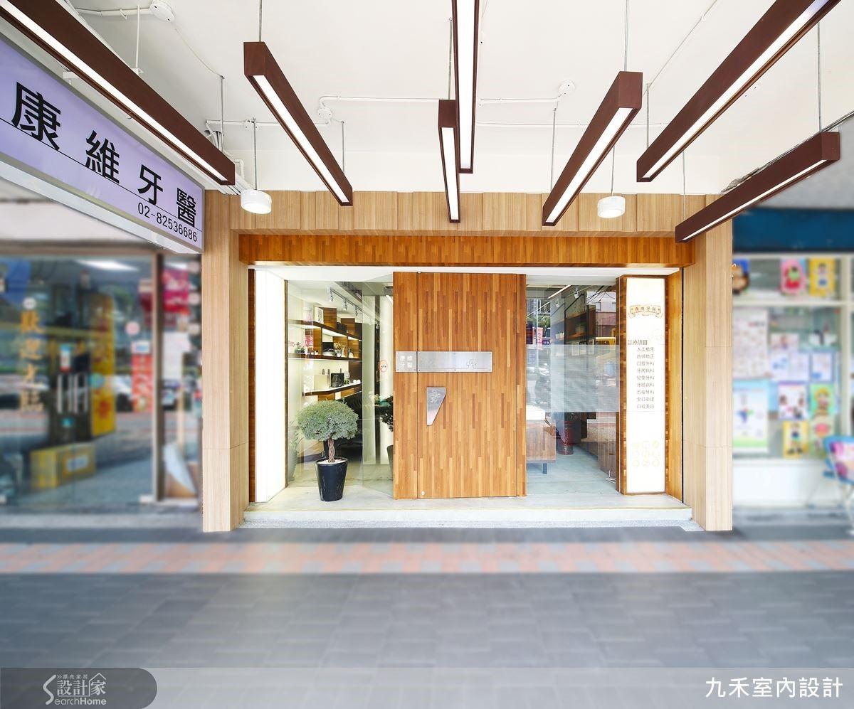 帶著活力感的溫潤木質與玻璃落地窗,宛如展開雙臂,歡迎著每一位前來看牙的顧客。