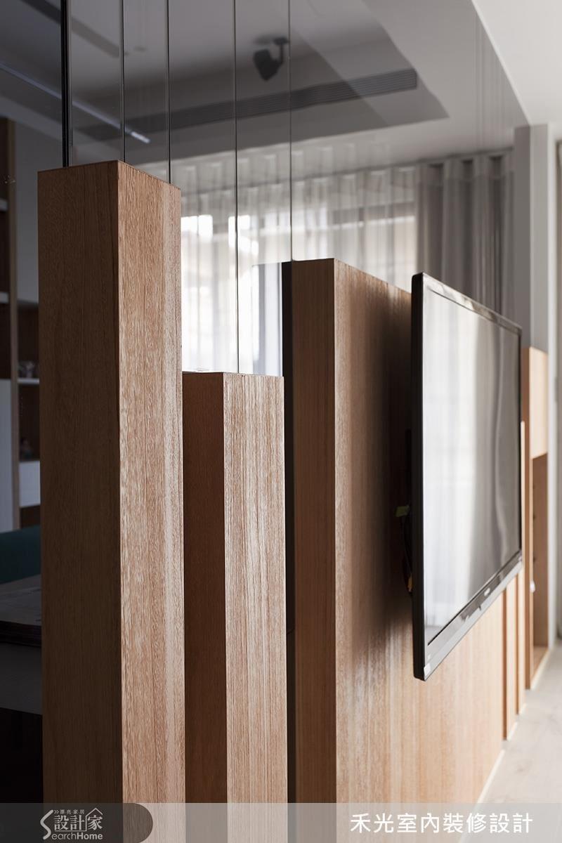 隨木質格柵發展向上的玻璃切割條紋,引導視覺延伸,達到挑高修長的視覺暗示。