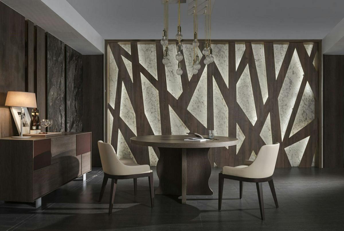 鐵橡洗白木紋牆面與安格拉灰石紋交錯嵌入,營造自然氣象。
