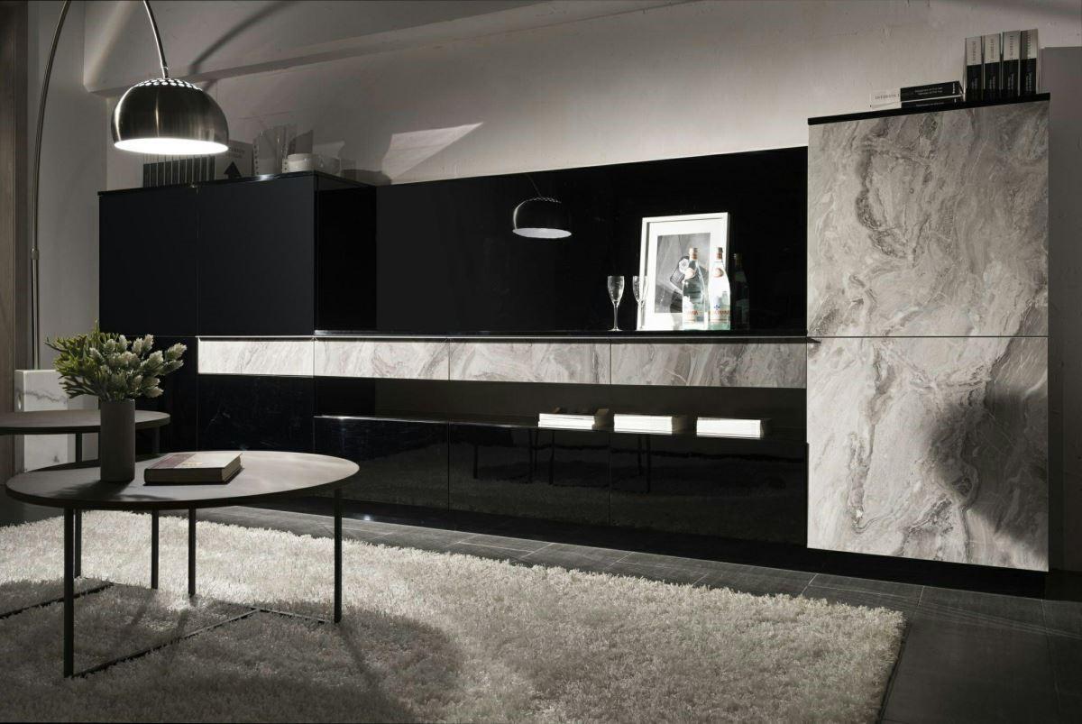 安格拉白的大理石紋板材,以不規則紋理,揮灑出暈染的層次感,彷彿取材大自然的律動,與黑色鋼烤面板搭配更顯大器。