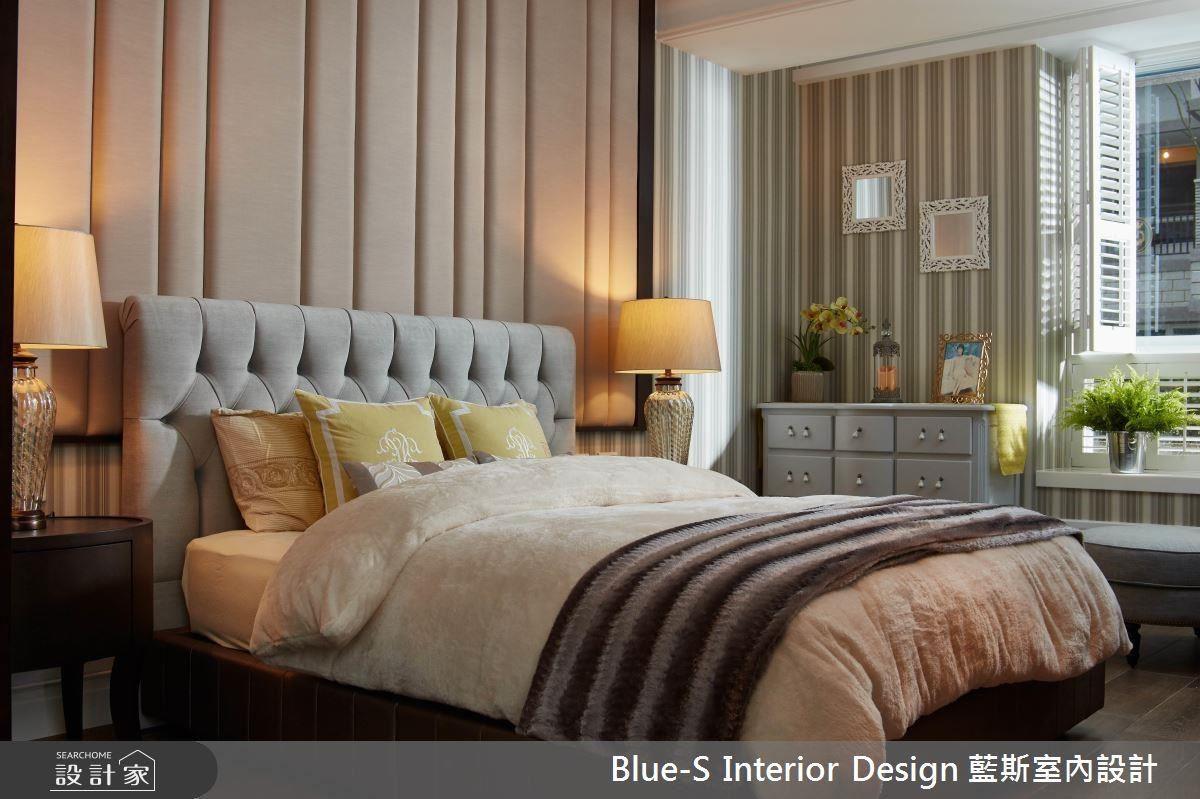 直條紋的壁紙展現俐落時尚感,長條式的設計是屋主的喜愛。