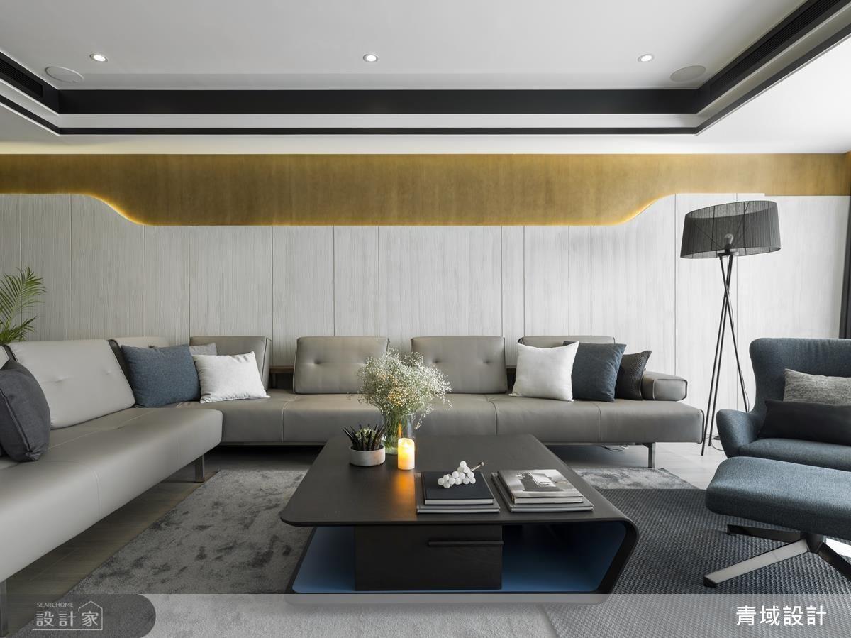 沙發背牆大膽運用弧型設計為偌大公領域增添視覺動態,也藉清水模及木皮手作質感打造原始林野的沉穩靜謐。