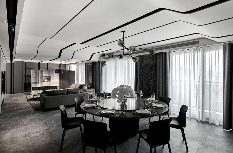 選用實體圓柱型的餐桌,賦予整體空間大器和諧的視覺感。