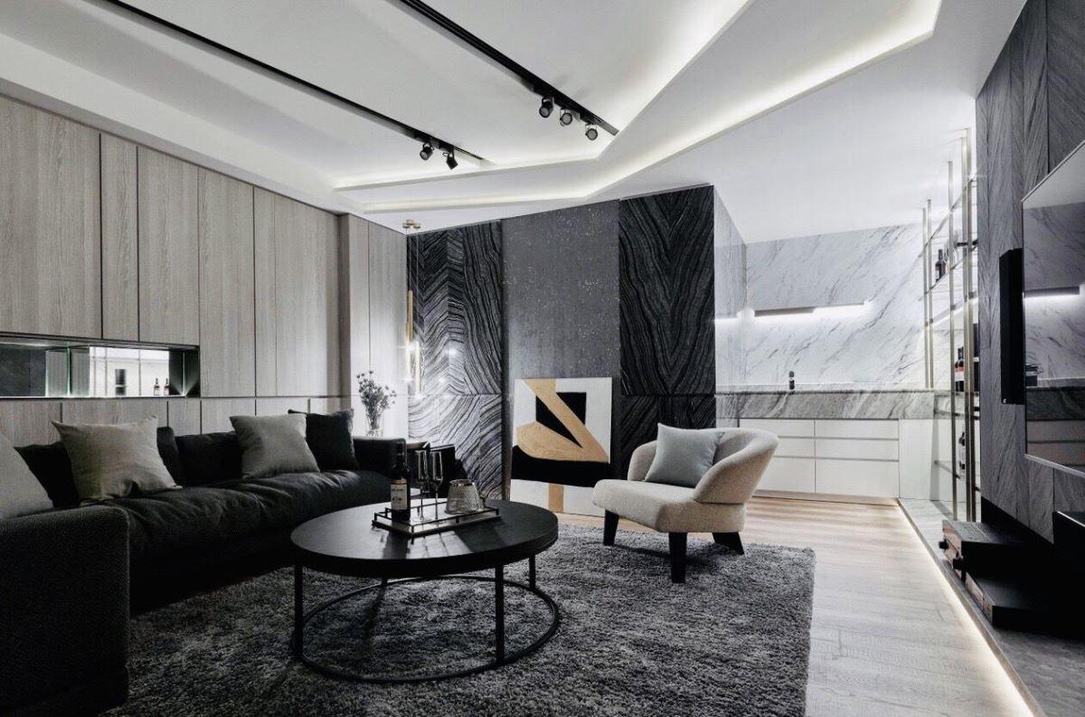 視聽室透過灰階調性地毯,為空間挹注濃厚沉穩氣息。