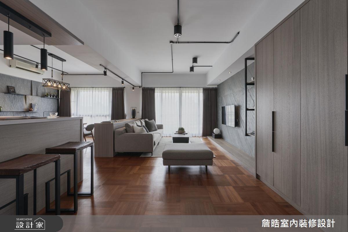 彷彿以天花板為畫布,鐵件為畫筆,軌道燈與吊燈的鐵件材質,在灰白色的天花板為襯底的視覺上勾勒出俐落的線條。